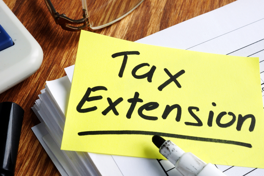Tax Extension note on stack of forms