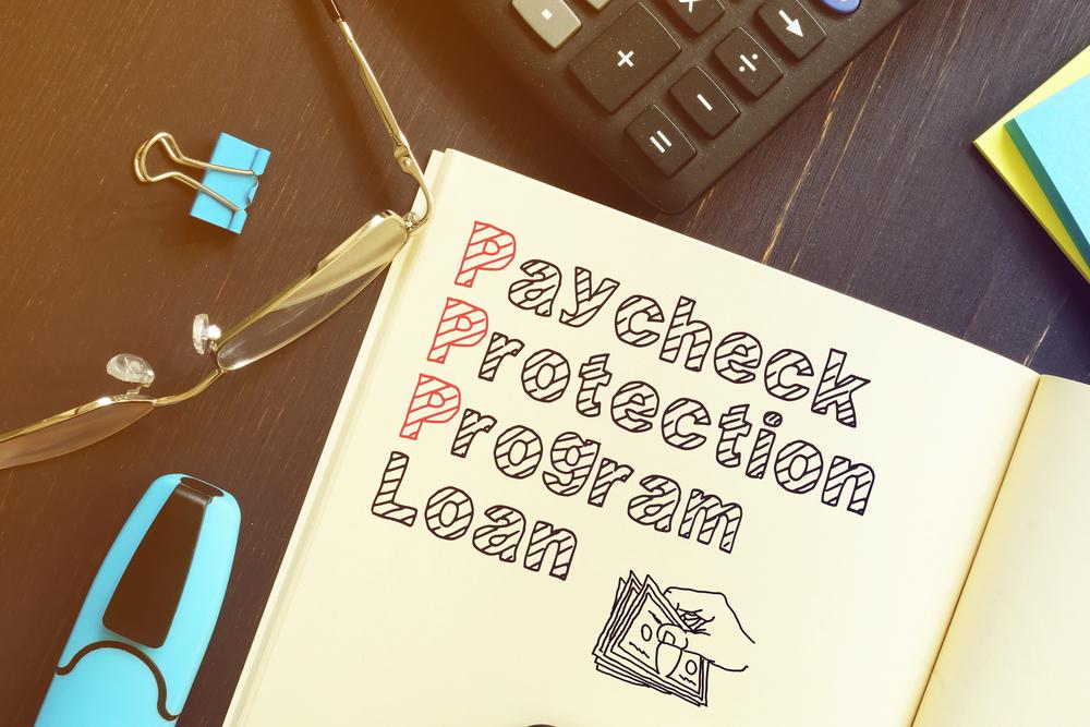 PPP written in notebook by keyboard