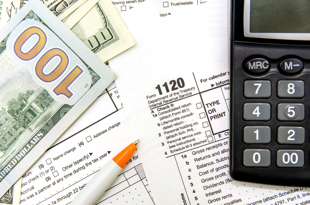 Tax forms, money, and calculator