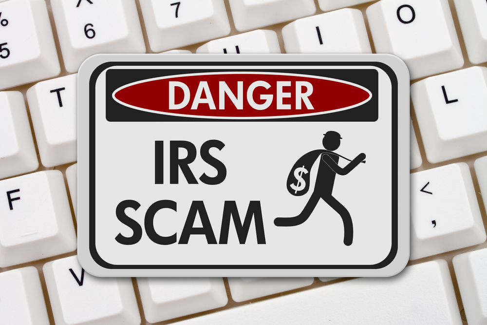 Danger IRS Scam sign on keyboard