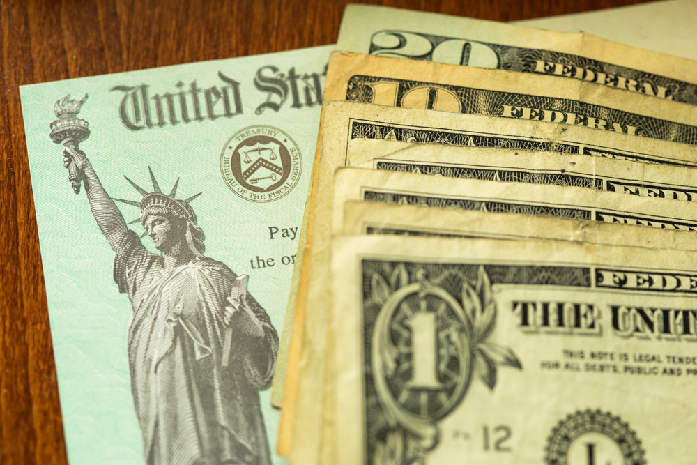 IRS check and cash on desk